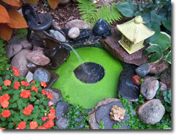 A diminutive pond makes a nice splash by the patio